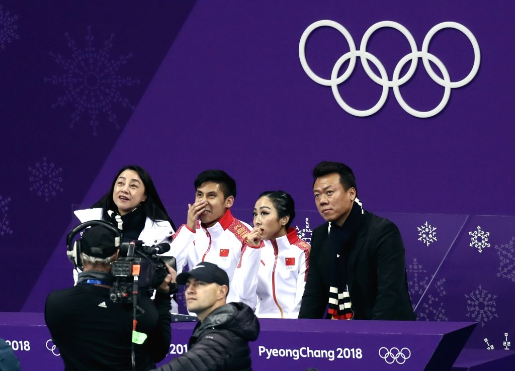 PYEONGCHANG, Feb. 15, 2018 - Sui Wenjing (2nd R, Back) and Han Cong (3rd R, Back) of China wait for scores after the pair skating free skating of figure skating at the 2018 PyeongChang Winter Olympic ...