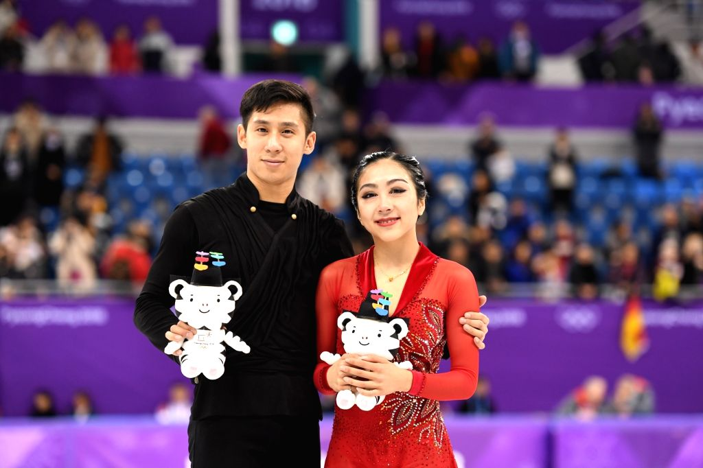 PYEONGCHANG, Feb. 15, 2018 - Sui Wenjing (R) and Han Cong of China pose for photos during the venue ceremony after the pair skating free skating of figure skating at the 2018 PyeongChang Winter ...