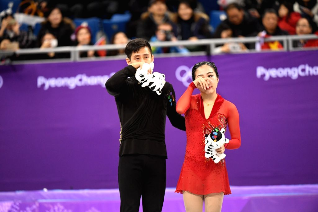 PYEONGCHANG, Feb. 15, 2018 - Sui Wenjing (R) and Han Cong of China wipe away their tears during the venue ceremony after the pair skating free skating of figure skating at the 2018 PyeongChang Winter ...
