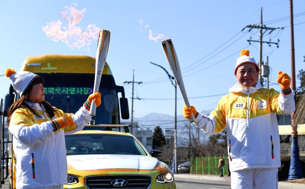 PYEONGCHANG, Feb. 6, 2018 - Chinese torch bearer Zheng Jie (R) participates in the Olympic Torch Relay in Donghae, Gangwon-do province, South Korea, Feb. 6, 2018. The 2018 PyeongChang Olympic Winter ...