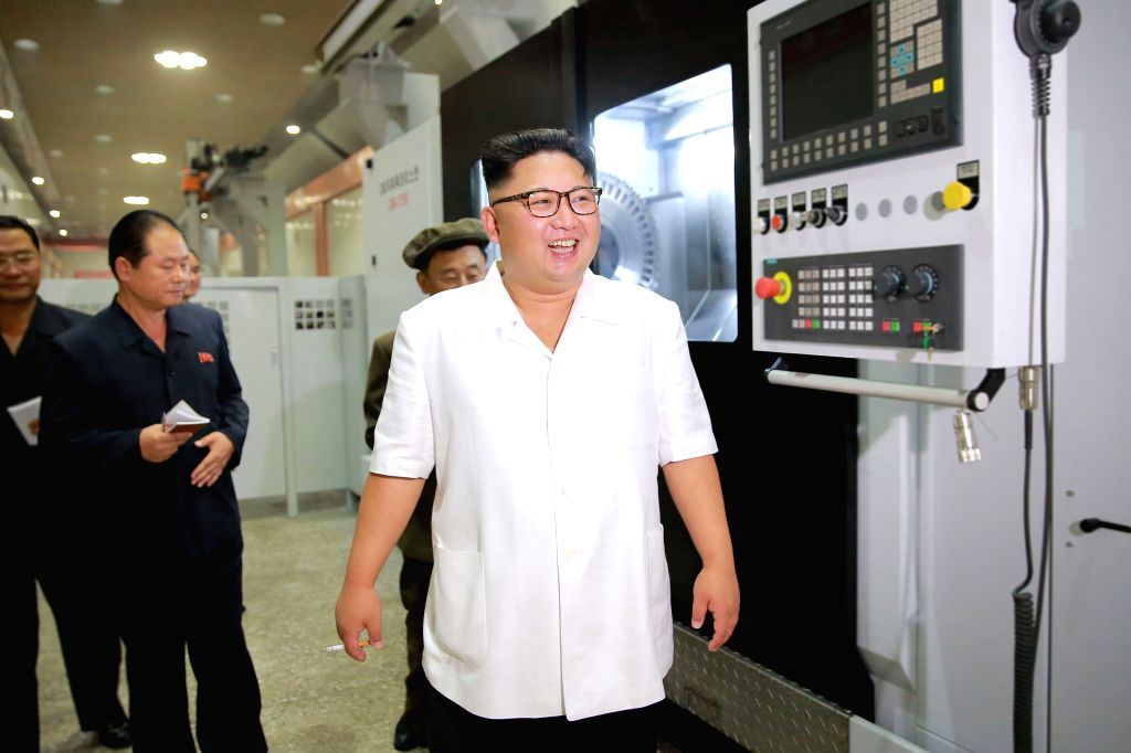 PYONGYANG, Aug. 10, 2016 - Photo provided by Korean Central News Agency (KCNA) on Aug. 10, 2016 shows top leader of the Democratic People's Republic of Korea (DPRK) Kim Jong Un recently giving field ...