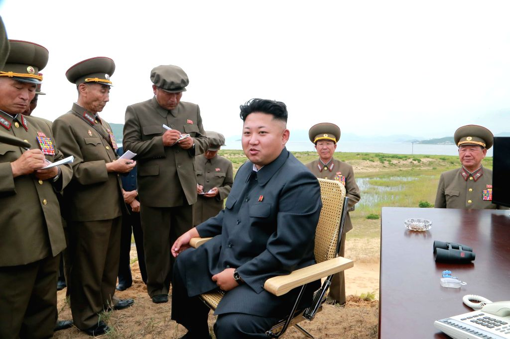 The photo provided by KCNA on Aug. 15, 2014 shows top leader of the Democratic People's Republic of Korea (DPRK) Kim Jong Un (C) guides the test-fire of a ...