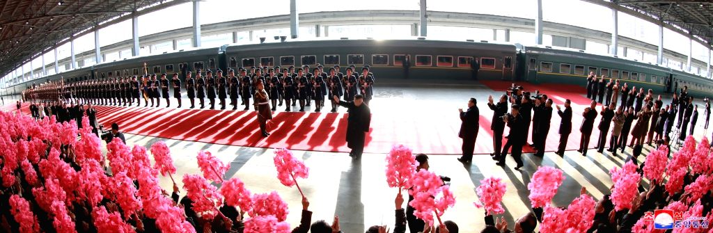 PYONGYANG, Feb. 24, 2019 - In this photo provided by the Korean Central News Agency (KCNA) on Feb. 24, 2019, Kim Jong Un (C), top leader of the Democratic People's Republic of Korea (DPRK), is seen ...