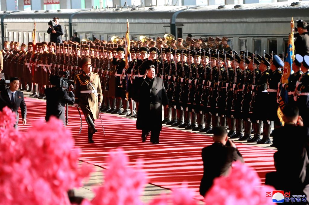 PYONGYANG, Feb. 24, 2019 - In this photo provided by the Korean Central News Agency (KCNA) on Feb. 24, 2019, Kim Jong Un (C), top leader of the Democratic People's Republic of Korea (DPRK), attends a ...