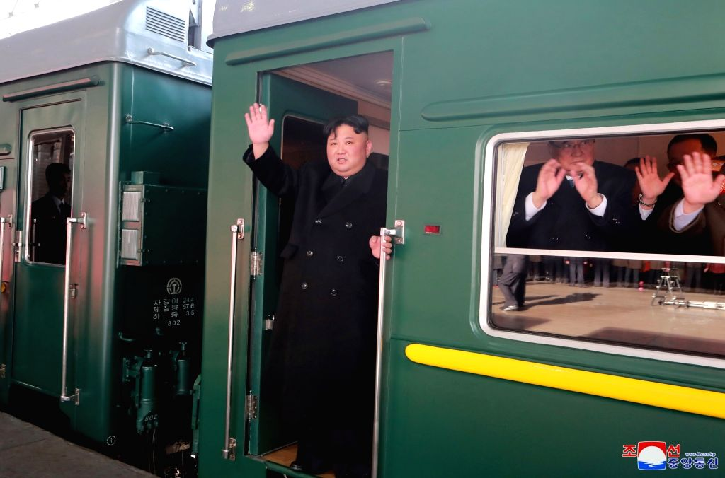 PYONGYANG, Feb. 24, 2019 - In this photo provided by the Korean Central News Agency (KCNA) on Feb. 24, 2019, Kim Jong Un, top leader of the Democratic People's Republic of Korea (DPRK), waves to ...
