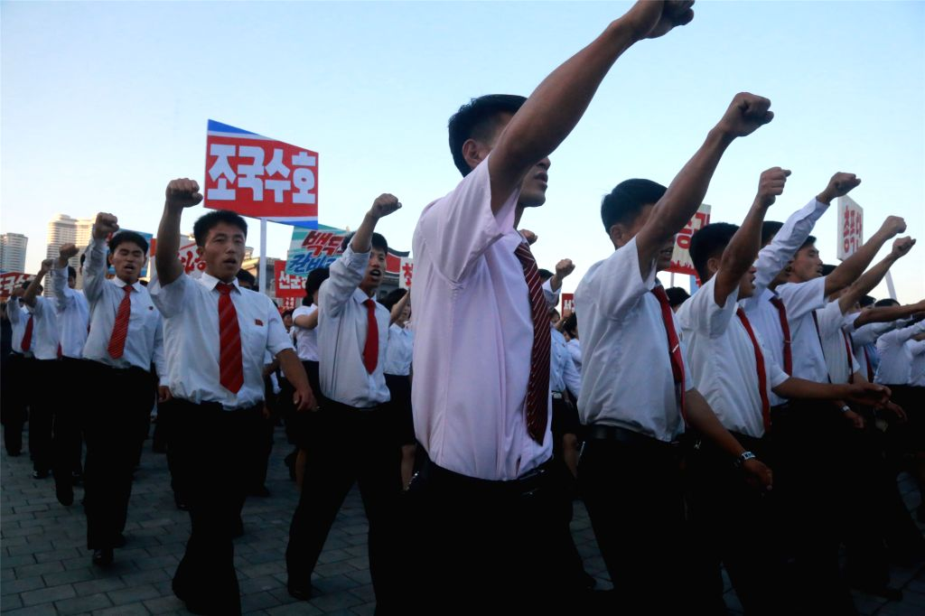 PYONGYANG, June 26, 2016 - Local residents take part in an anti-U.S. rally to mark the 66th anniversary of the start of the Korean War, in Pyongyang, the Democratic People's Republic of Korea (DPRK), ...