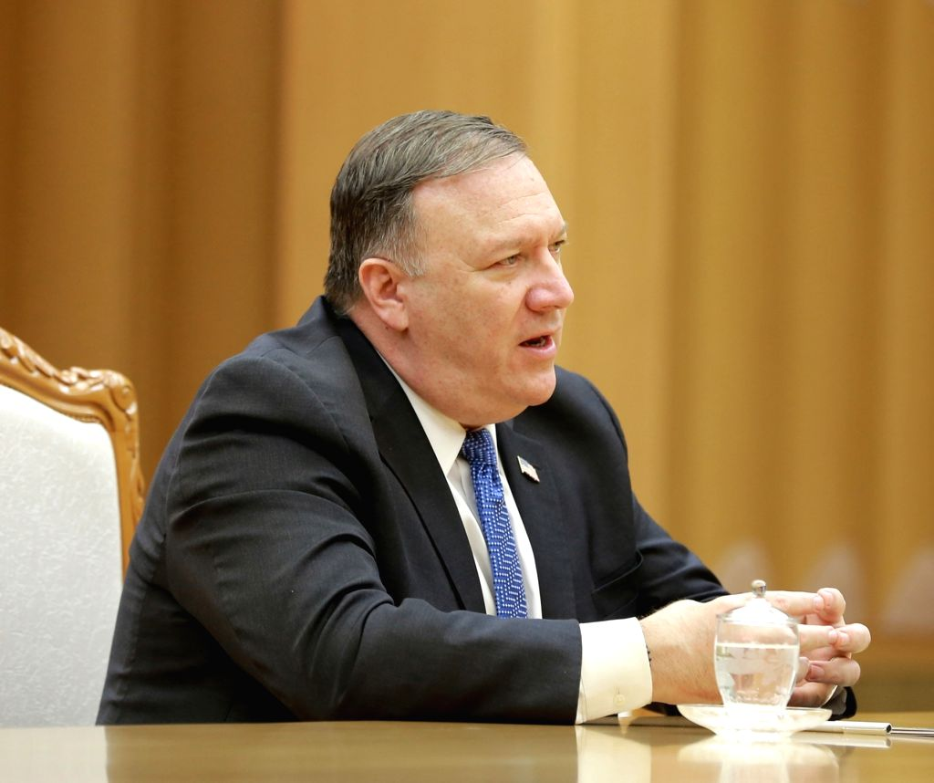 PYONGYANG, May 10, 2018 (Xinhua) -- Photo provided by the Korean Central News Agency (KCNA) on May 10, 2018 shows visiting U.S. Secretary of State Mike Pompeo talking with Kim Jong Un (not in the picture), top leader of the Democratic People's Republ
