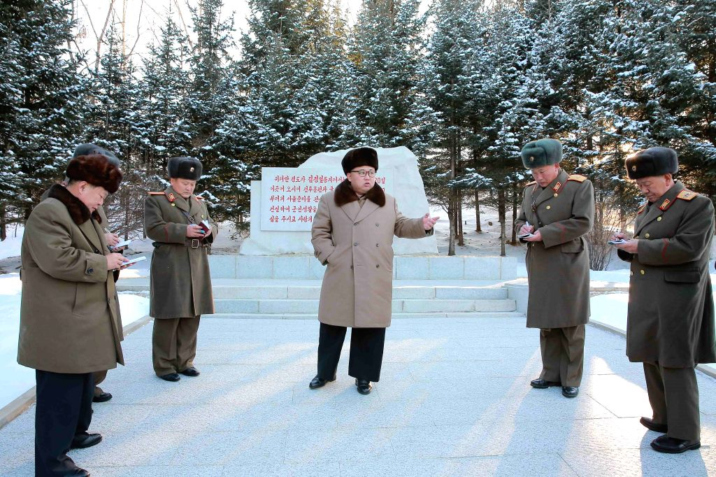 PYONGYANG, Nov. 25, 2016 - Photo provided by Korean Central News Agency (KCNA) on Nov. 25, 2016 shows top leader of the Democratic People's Republic of Korea (DPRK) Kim Jong Un (C) recently ...