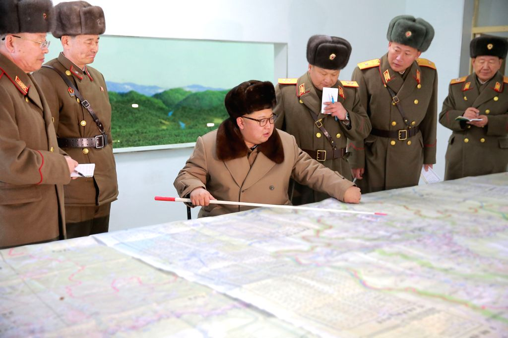 PYONGYANG, Nov. 25, 2016 - Photo provided by Korean Central News Agency (KCNA) on Nov. 25, 2016 shows top leader of the Democratic People's Republic of Korea (DPRK) Kim Jong Un (3rd L) recently ...