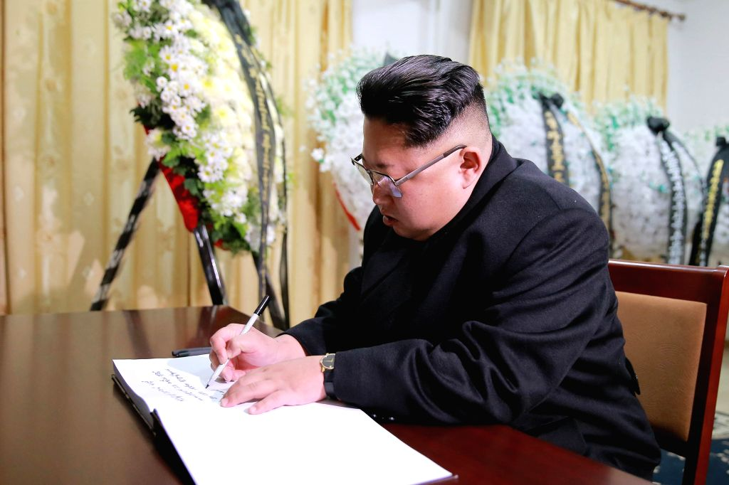 PYONGYANG, Nov. 29, 2016 - Photo provided by Korean Central News Agency (KCNA) shows top leader of the Democratic People's Republic of Korea (DPRK) Kim Jong Un writes a message in the book for ...