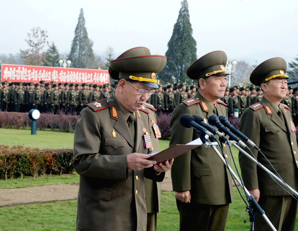 Photo provided by Korean Central News Agency (KCNA) on Nov. 8, 2014 shows the Director of the General Political Bureau of the Korean People's Army (KPA) Hwang Pyong So (1st L) addressing ..