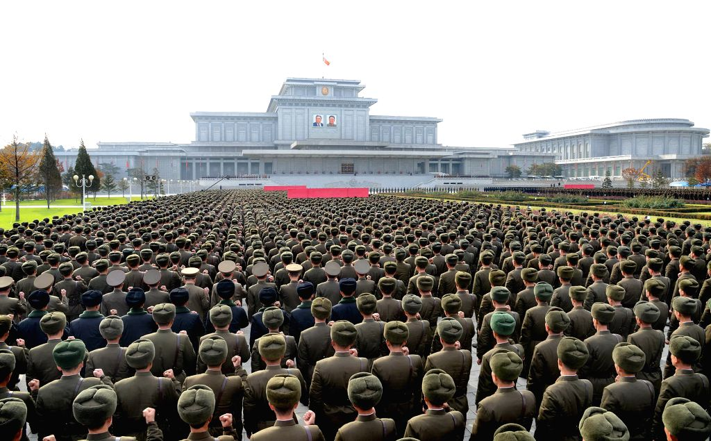 Photo provided by Korean Central News Agency (KCNA) on Nov. 8, 2014 shows participants in the 3rd meeting of battalion commanders and political instructors of the Korean People's Army ...