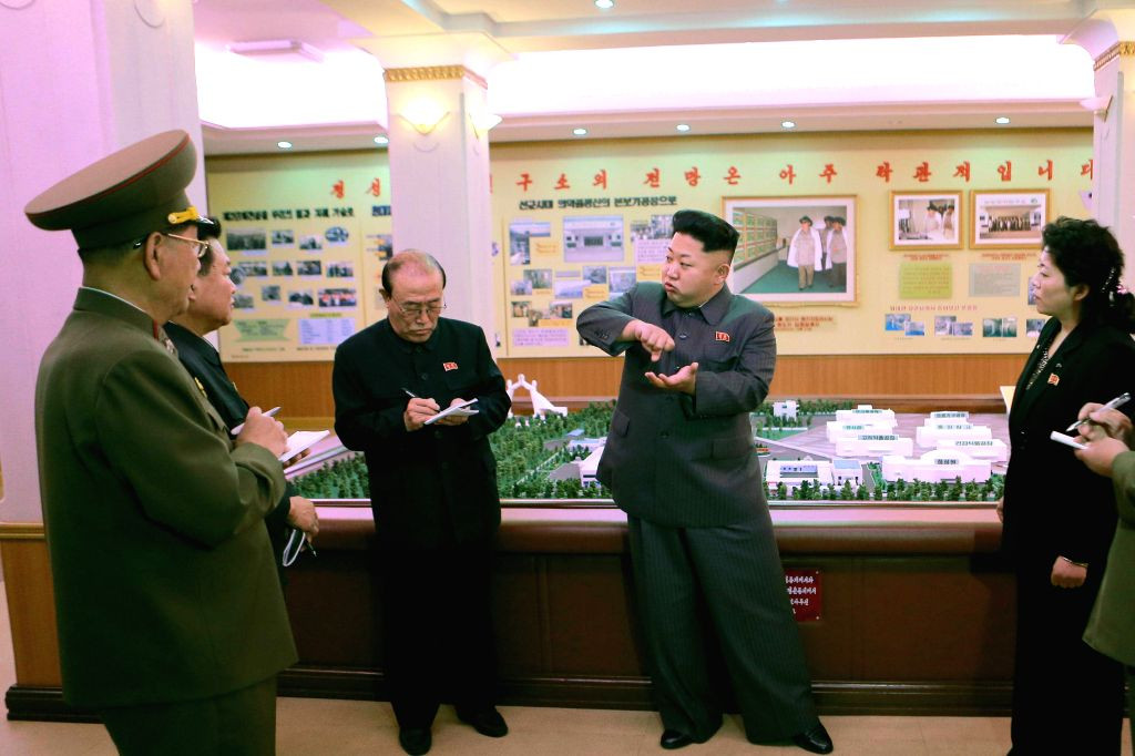 Photo provided by Korean Central News Agency (KCNA) on Nov. 8, 2014 shows top leader of the Democratic People's Republic of Korea (DPRK) Kim Jong Un (4th L) providing field guidance to the