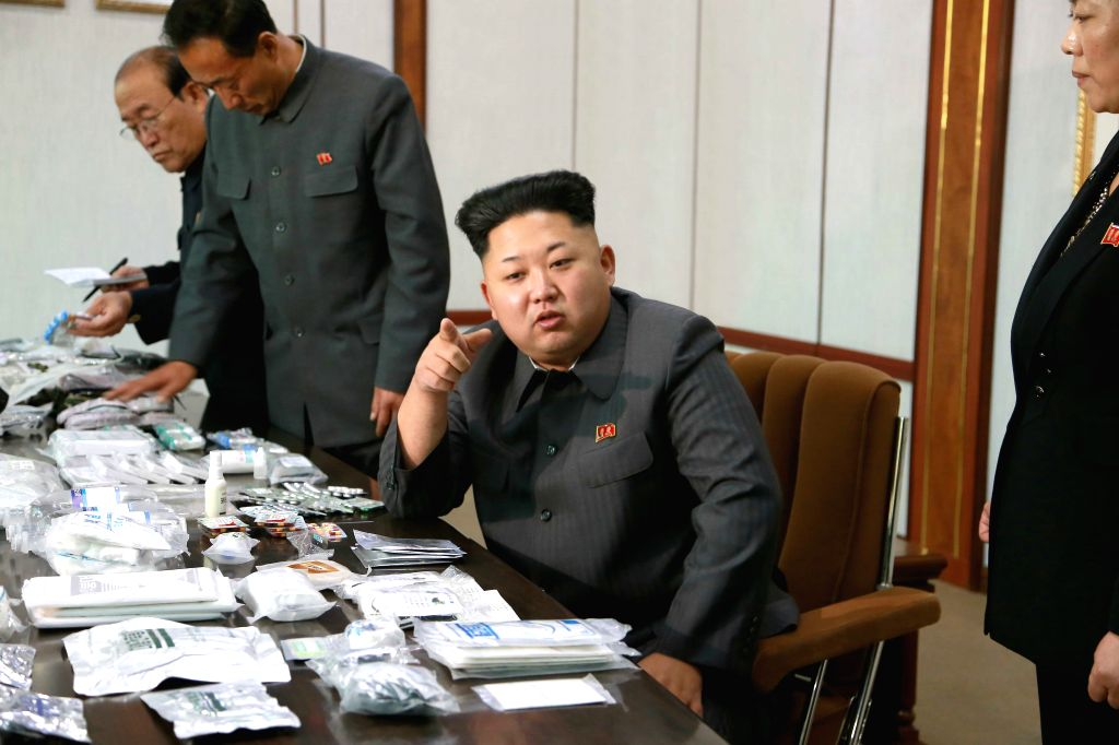 Photo provided by Korean Central News Agency (KCNA) on Nov. 8, 2014 shows top leader of the Democratic People's Republic of Korea (DPRK) Kim Jong Un (2nd R) providing field guidance to the