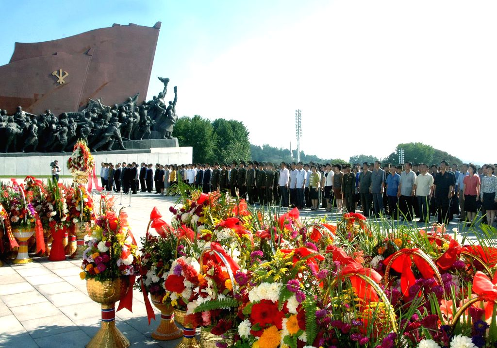 Photo provided by Korean Central News Agency on Sept. 9, 2014 shows people present bouquets to the statues of former leaders Kim Il Sung and Kim Jong Il on the ...