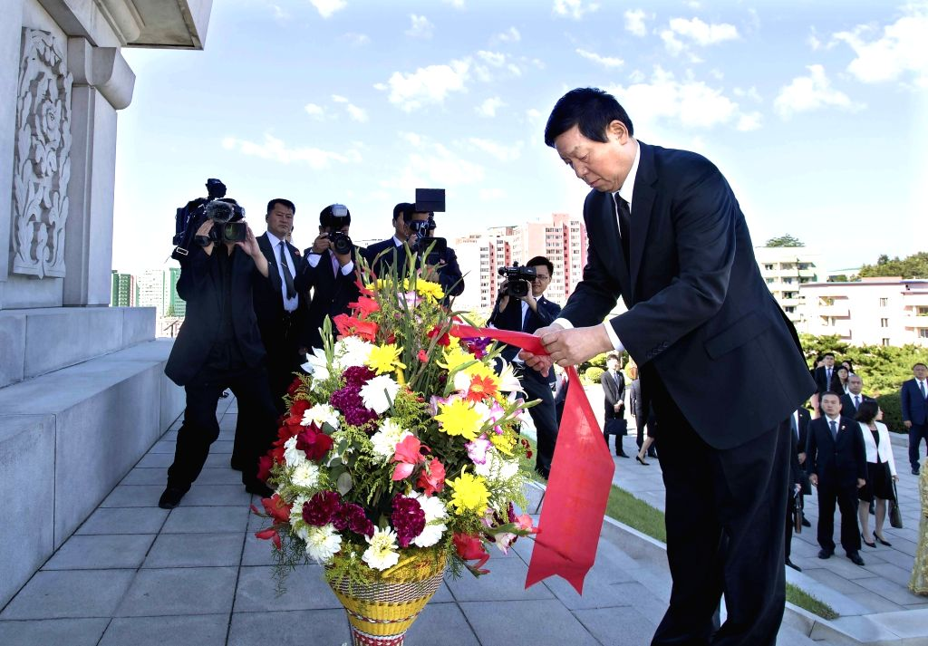 PYONGYANG, Sept. 10, 2018 - China's top legislator Li Zhanshu visits the Friendship Tower, which is dedicated to fallen soldiers of the Chinese People's Volunteer Army during the 1950-1953 Korean ...