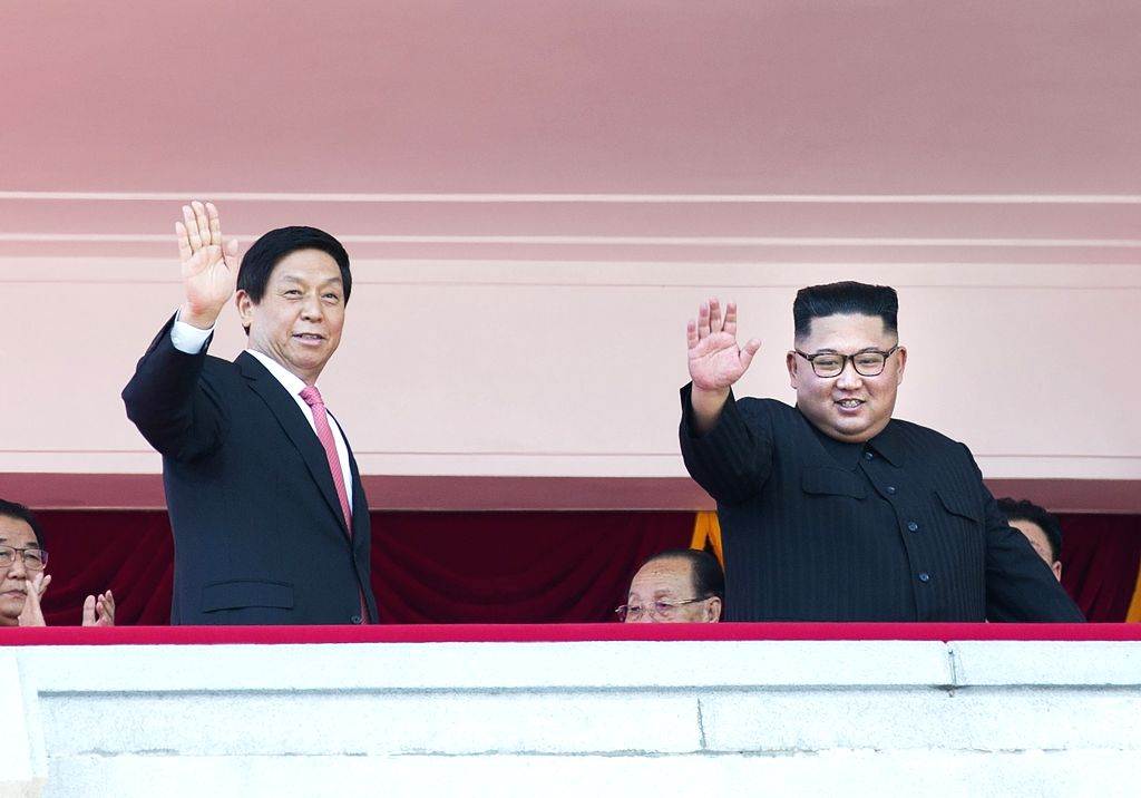 PYONGYANG, Sept. 10, 2018 - China's top legislator Li Zhanshu (L), together with Kim Jong Un and other senior officials of the Democratic People's Republic of Korea (DPRK), attends the celebrations ...