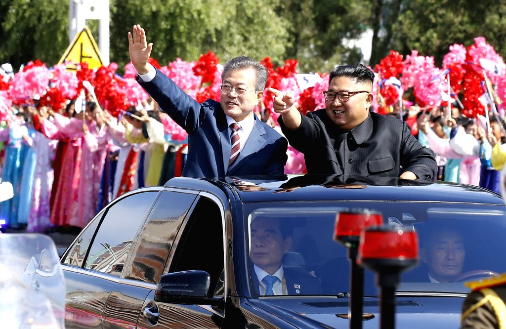 PYONGYANG, Sept. 18, 2018 - South Korean President Moon Jae-in (L) and top leader of the Democratic People's Republic of Korea (DPRK) Kim Jong Un (R) are seen in a sedan in Pyongyang, the DPRK, Sept. ...