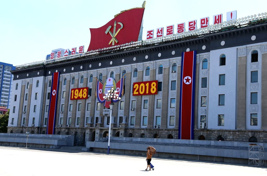 PYONGYANG, Sept. 8, 2018 - Photo taken on Sept. 8, 2018 shows a resident walking at Kim Il Sung Square in Pyongyang, capital of the Democratic People's Republic of Korea (DPRK). Sept. 9, 2018 marks ...