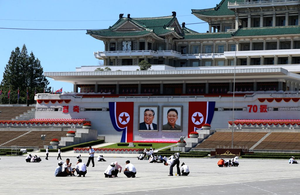 PYONGYANG, Sept. 8, 2018 - Photo taken on Sept. 8, 2018 shows people taking part in cleaning work at Kim Il Sung Square in Pyongyang, capital of the Democratic People's Republic of Korea (DPRK). ...