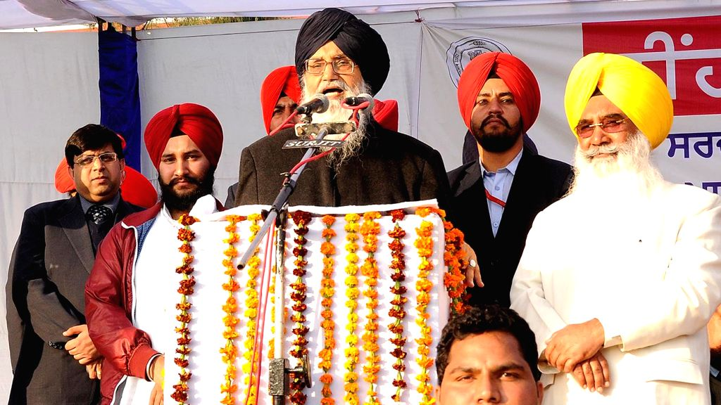 Punjab Chief Minister Parkash Singh Badal addresses at the foundation stone lying programme of a project to beautify an open drain at Qadian in Gurdaspur district of Punjab on Dec 10, 2014. - Parkash Singh Badal