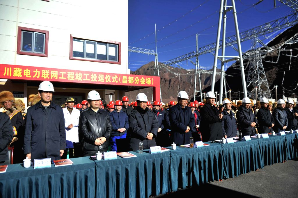 Qamdo (China): People take part in a launch ceremony of power transmission between southwest China's Tibet Autonomous Region and Sichuan Province, in Tibet's Qamdo Nov. 20, 2014.    (Xinhua/Wang ...
