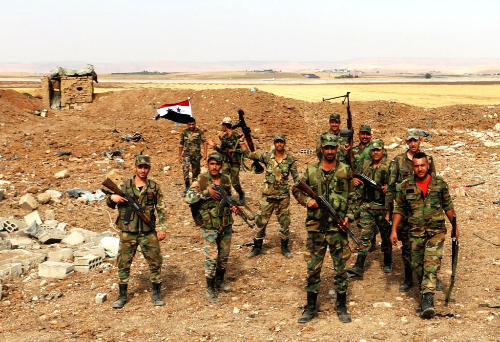 QAMISHLI (SYRIA), Oct. 28, 2019 (Xinhua) -- Syrian soldiers are seen upon deploying on the Syrian-Turkish border in the countryside of Qamishli city in al-Hasakah province, northeastern Syria, on Oct. 28, 2019. The Syrian government welcomes the with