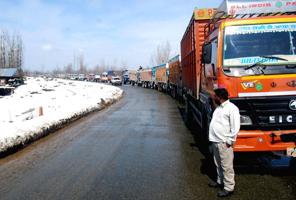 Trucks remain stranded on Jammu-Srinagar national highway which remained closed for the fourth consecutive day following landslides triggered by heavy rain in the Udhampur, Gangroo, Ramban ...