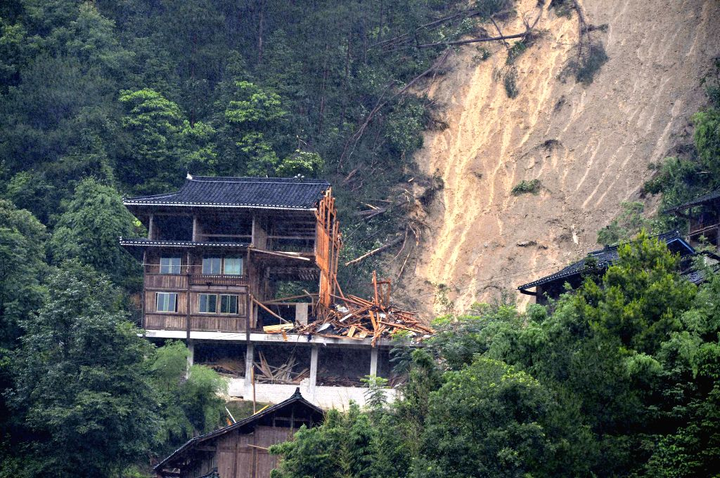 Photo taken on June 8, 2015 shows the accident scene where a landslide took place in Jidao Village, Kaili City of southwest China's Guizhou Province. A landslide ...