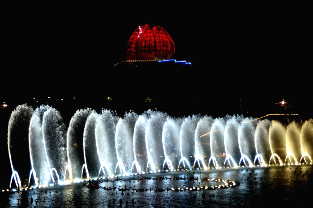 Photo taken on April 17, 2014 shows musical fountains in the 2014 International Horticultural Exposition in Qingdao, east China's Shandong Province. Lights are ...