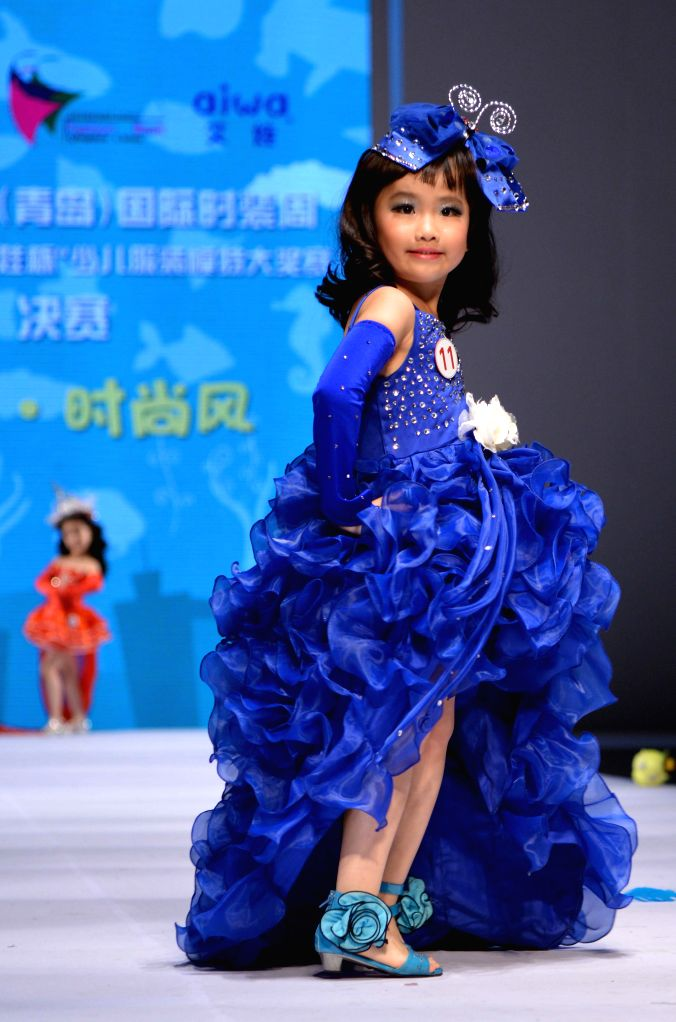 A contestant takes part in a  model contest for kids during the 2014 China (Qingdao) International Fashion Week in Qingdao, east China's Shandong Province, April ..