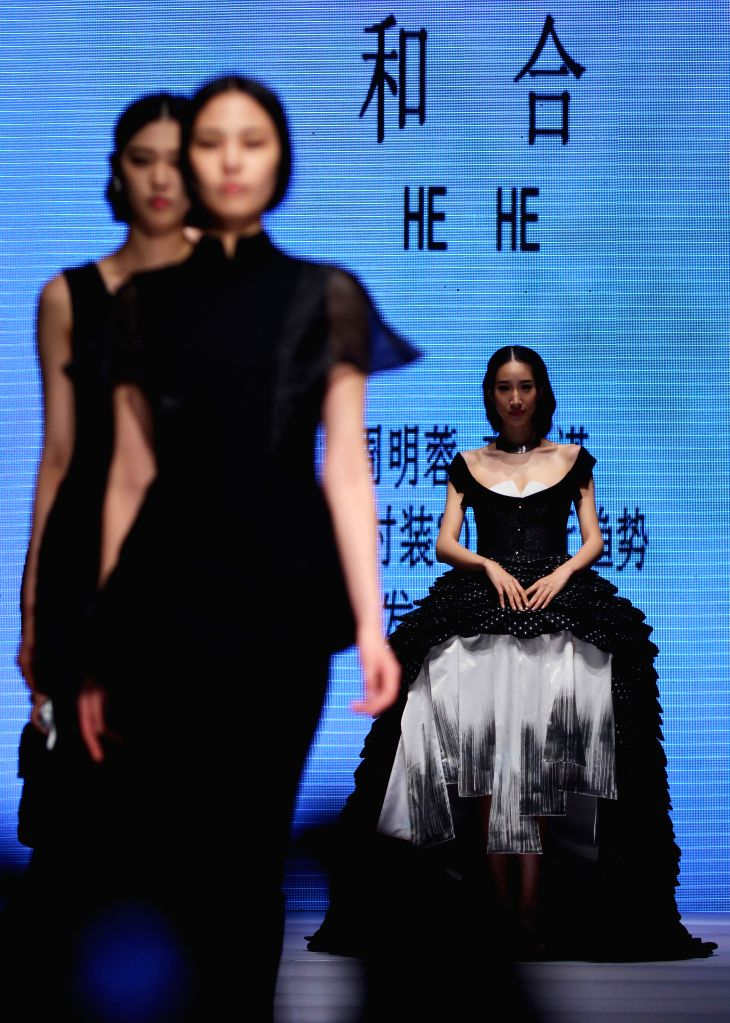 Models present creations during the 2014 China (Qingdao) International Fashion Week in Qingdao, east China's Shandong Province, April 27, 2014. The five-day ...