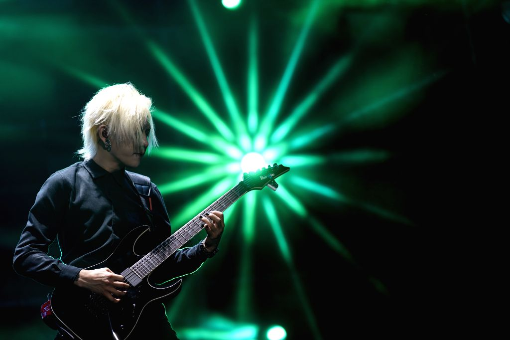 QINGDAO, Aug. 25, 2019 - An artist performs during the 2019 Midi Rock Night in Qingdao, east China's Shandong Province, Aug. 24, 2019. The 5th Tiantaishan Music Festival, which opened on July. 13, ...