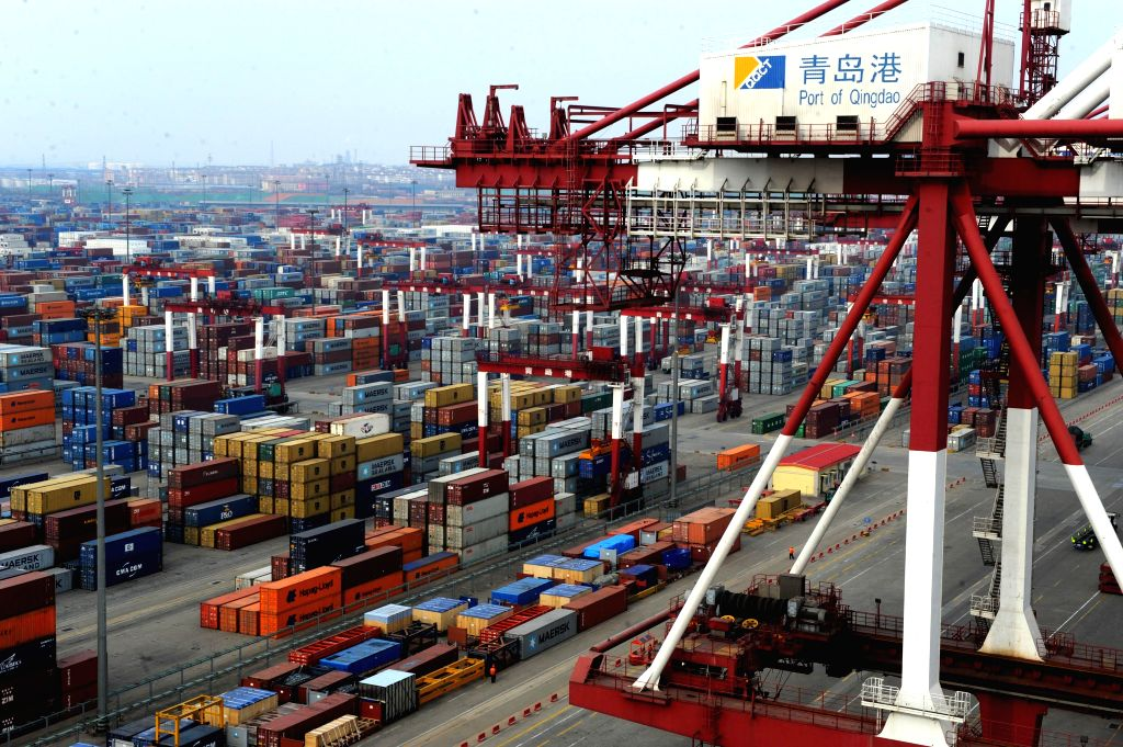 QINGDAO, Feb. 13, 2014 (Xinhua) -- Photo taken on Feb. 12, 2014 shows the container terminal at the port of Qingdao, a coastal city in east China's Shandong Province. According to the latest data released by Shanghai Shipping Exchange, the cargo thro