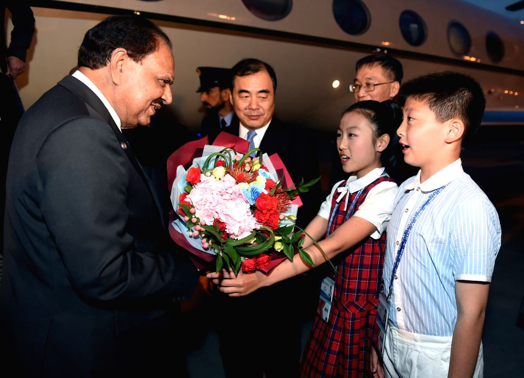 QINGDAO, June 8, 2018 - Pakistani President Mamnoon Hussain (1st L) is greeted upon his arrival in Qingdao, east China's Shandong Province, June 8, 2018. Hussain is here to attend the upcoming 18th ...