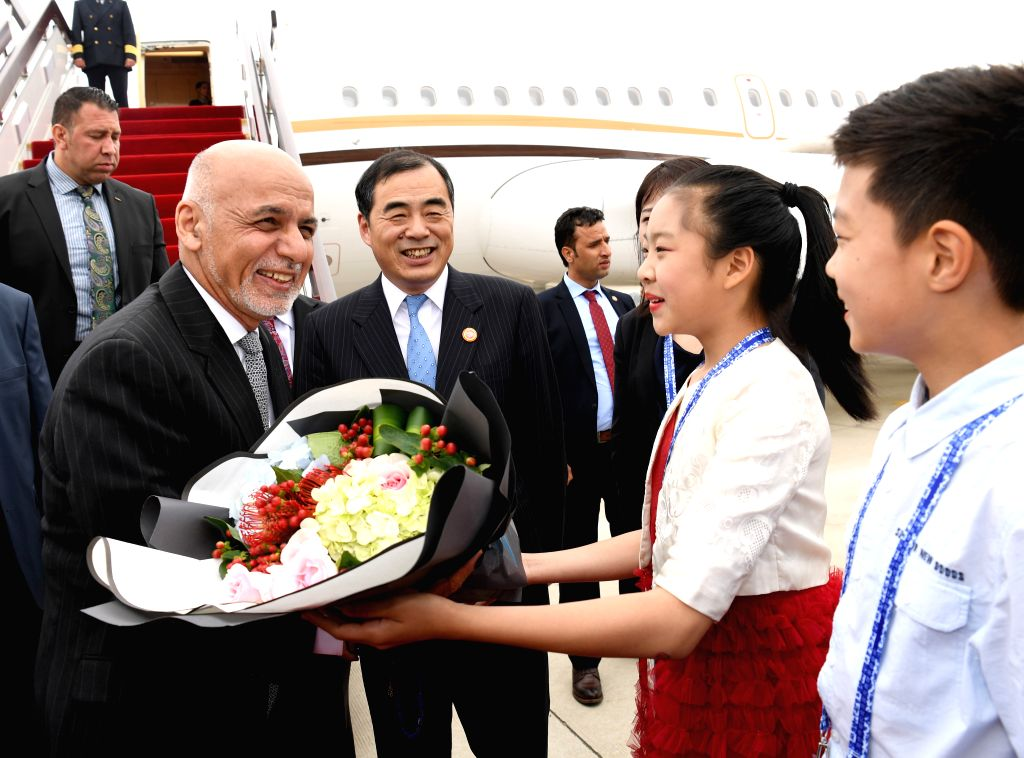 QINGDAO, June 9, 2018 - Afghan President Ashraf Ghani (1st L, front) is greeted upon his arrival in Qingdao, east China's Shandong Province, June 9, 2018. Ghani is here to attend the 18th Shanghai ...