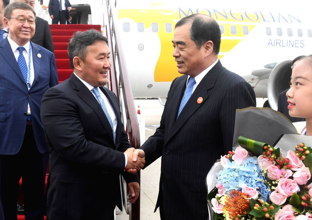 QINGDAO, June 9, 2018 - Mongolian President Khaltmaa Battulga (L, front) is greeted upon his arrival in Qingdao, east China's Shandong Province, June 9, 2018. Battulga is here to attend the 18th ...