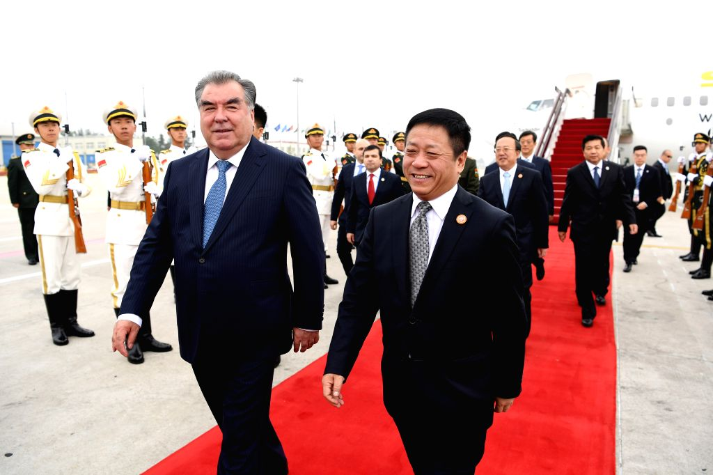 QINGDAO, June 9, 2018 - Tajik President Emomali Rahmon (L, front) arrives in Qingdao, east China's Shandong Province, June 9, 2018. Rahmon is here to attend the 18th Shanghai Cooperation Organization ...