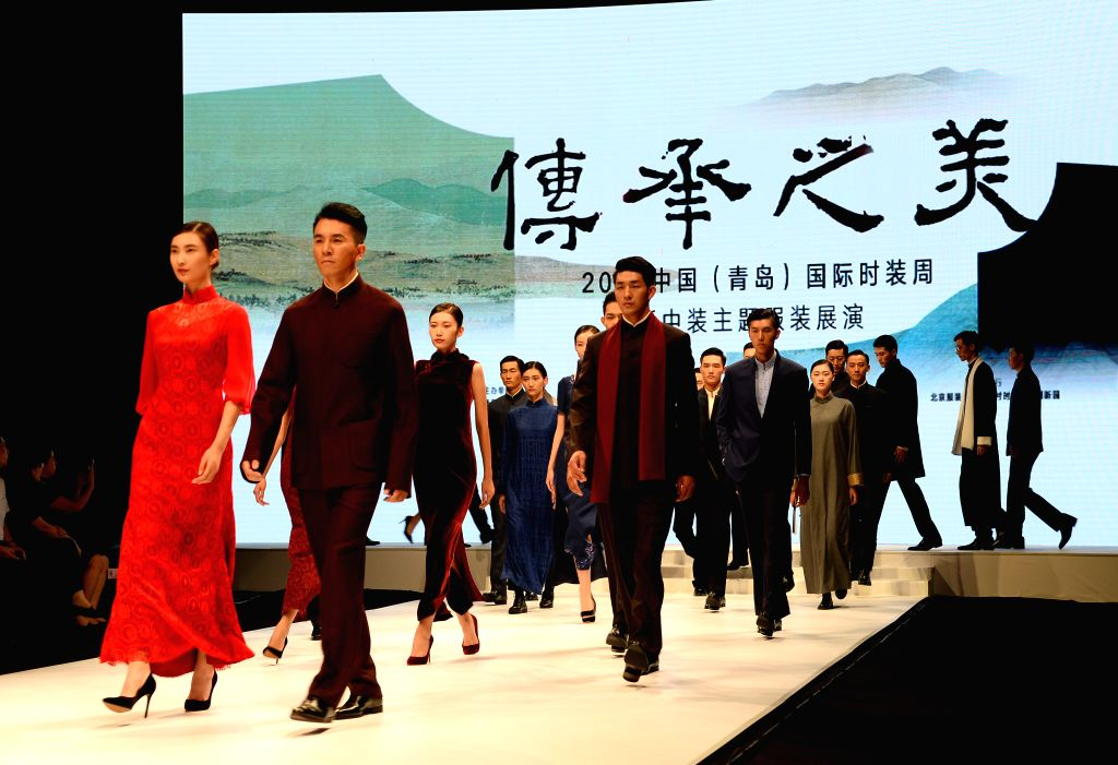 QINGDAO, Sept. 17, 2017 - Models show Chinese style fashion during the 2017 China (Qingdao) International Fashion Week in Qingdao, east China's Shandong Province, Sept. 17, 2017.