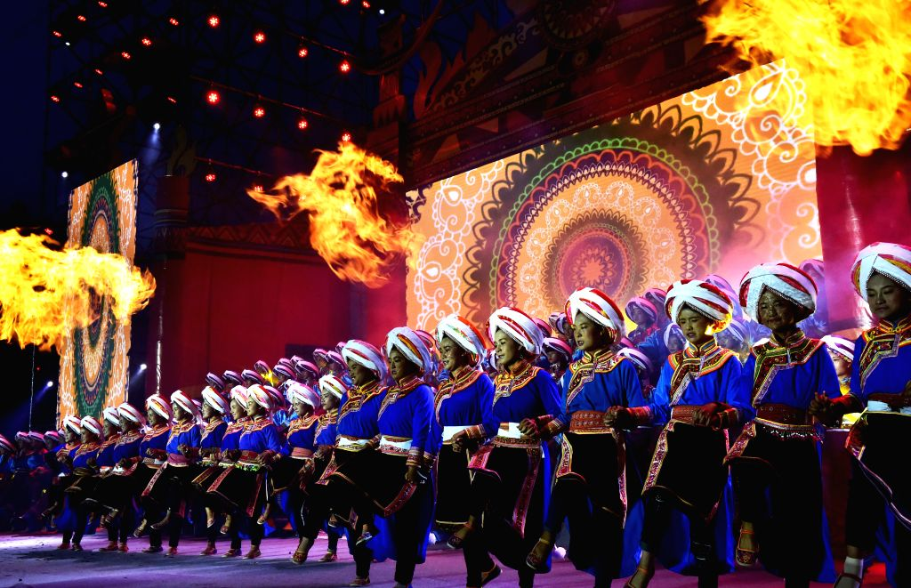QINGLONG, Aug. 16, 2017 - People of Yi ethnic group perform in the opening ceremony of the annual torch festival in Qinglong County, southwest China's Guizhou Province, Aug. 15, 2017. The 7th Torch ...