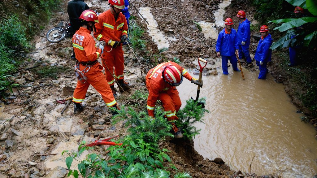 QINGYUAN, April 30, 2019 - Rescuers work at the accident site in Qingyuan City, south China's Guangdong Province, April 30, 2019. Four people were confirmed dead and two remained missing after a ...