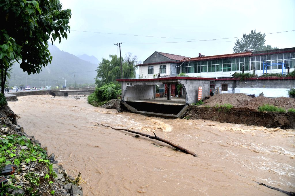 QINGZHOU, Aug. 11, 2019 - Photo taken on Aug. 11, 2019 shows a flooded river at Atuo Village of Wangfen Township in Qingzhou, east China's Shandong Province. The super typhoon Lekima is expected to ...
