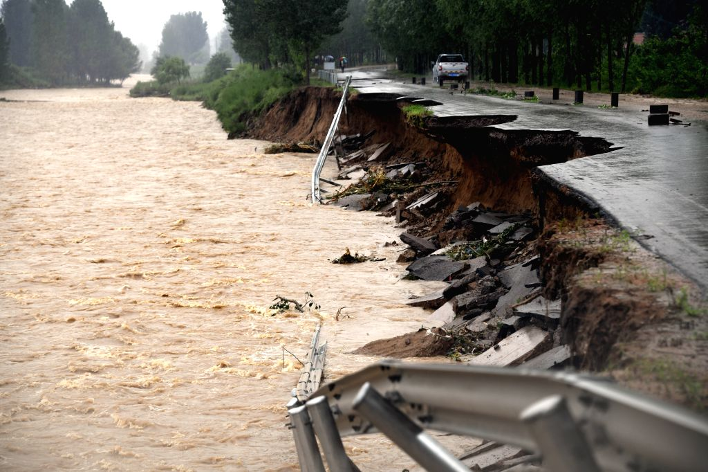 QINGZHOU, Aug. 11, 2019 - Photo taken on Aug. 11, 2019 shows a road damaged by the flood in Xinzhai Township of Linqu County, east China's Shandong Province. The super typhoon Lekima is expected to ...