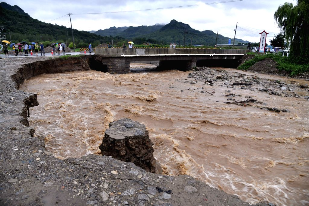 QINGZHOU, Aug. 11, 2019 - Photo taken on Aug. 11, 2019 shows the river bank damaged by the flood at Atuo Village of Wangfen Township in Qingzhou, east China's Shandong Province. The super typhoon ...