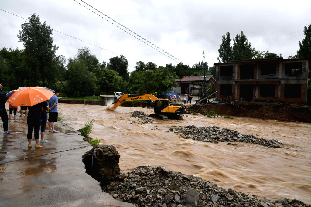QINGZHOU, Aug. 11, 2019 (Xinhua) -- An excavator clears the riverway at Atuo Village of Wangfen Township in Qingzhou, east China's Shandong Province, Aug. 11, 2019. The super typhoon Lekima is expected to make a second landing along the coastline in