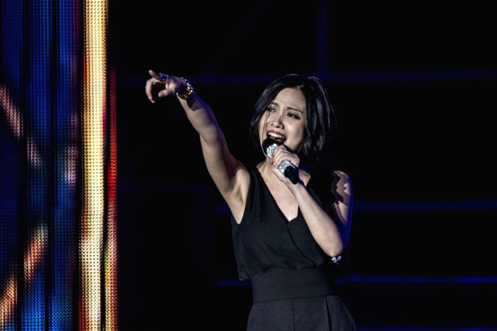 File photo taken on Aug. 27, 2014 shows singer Yao Beina at a performance staged in Qiqihar, northeast China's Heilongjiang Province. Yao died of breast cancer in ..