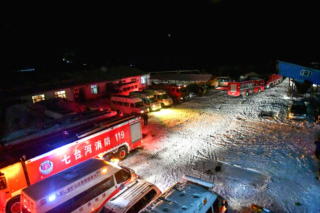 QITAIHE, Nov. 30, 2016 - Rescue vehicles are seen at the accident site in Qitaihe City, northeast China's Heilongjiang Province, Nov. 30, 2016. Twenty-two people were trapped in a coal mine accident ...