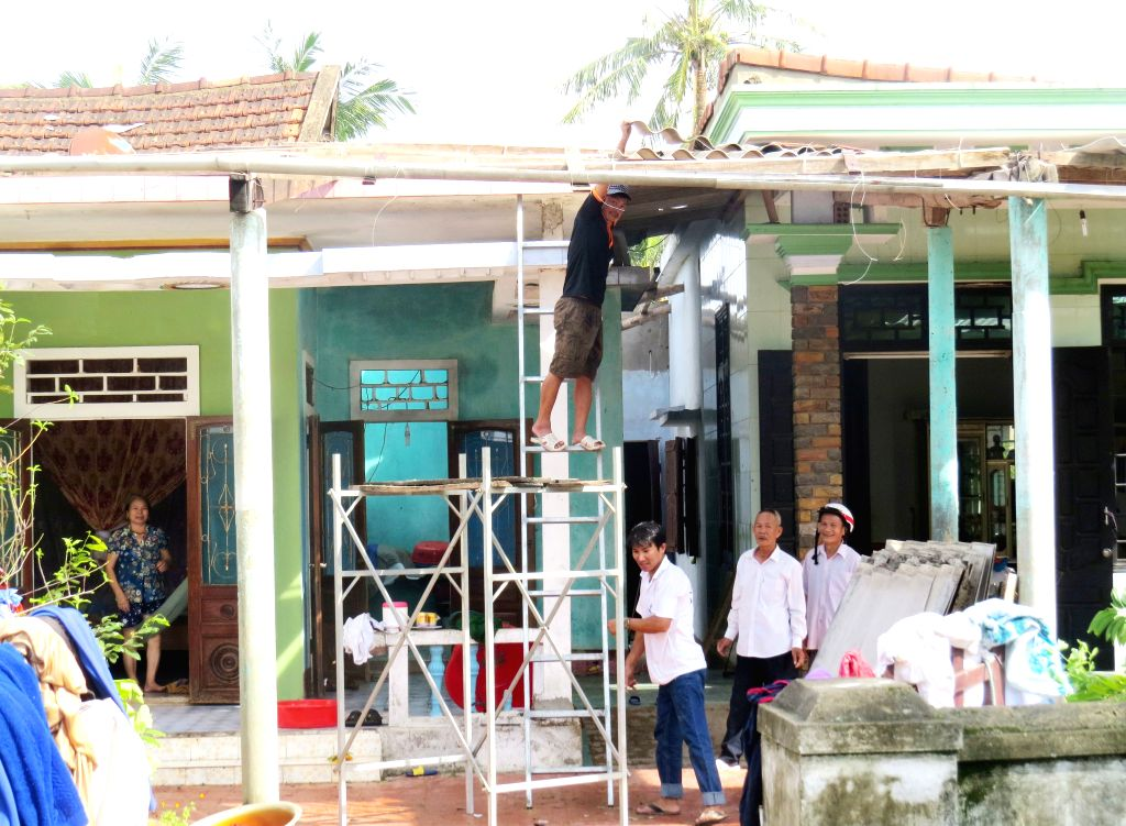 QUANG BINH, Sept. 16, 2017 - Local residents repair their house after typhoon Doksuri passed in Quang Binh province, central Vietnam, Sept. 16, 2017. Typhoon Doksuri has killed 8 people and injured ...