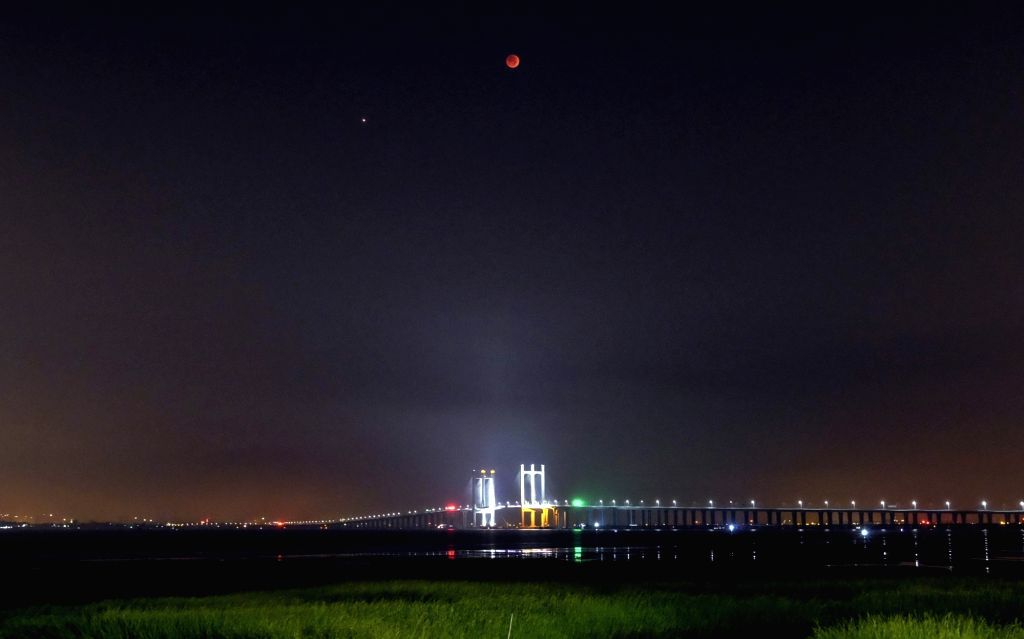 QUANZHOU, July 28, 2018 - The moon is seen during a lunar eclipse in Quanzhou, southeast China's Fujian Province, July 28, 2018. It is believed to be the longest lunar eclipse of the century.