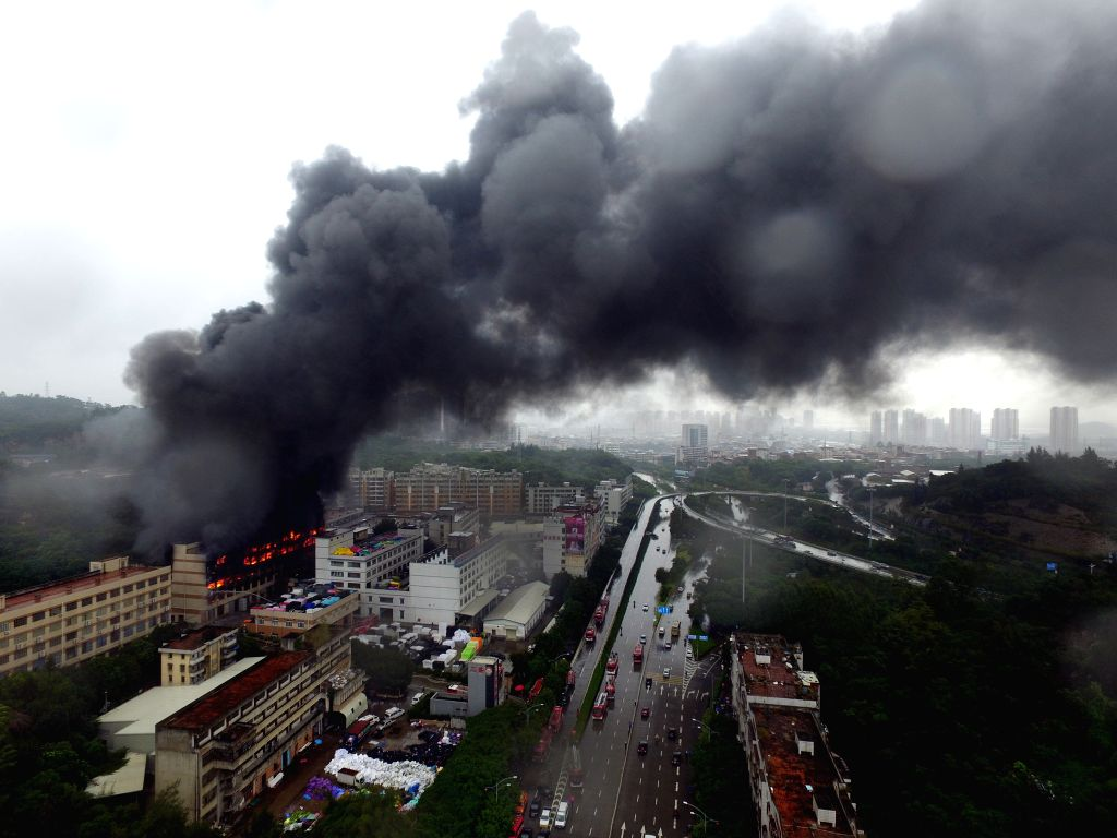 QUANZHOU, Nov. 26, 2016 - Photo taken on Nov. 26, 2016 shows the factory that caught fire in Quanzhou, southeast China's Fujian Province. A factory in Quanzhou caught fire on Saturday noon, and no ...